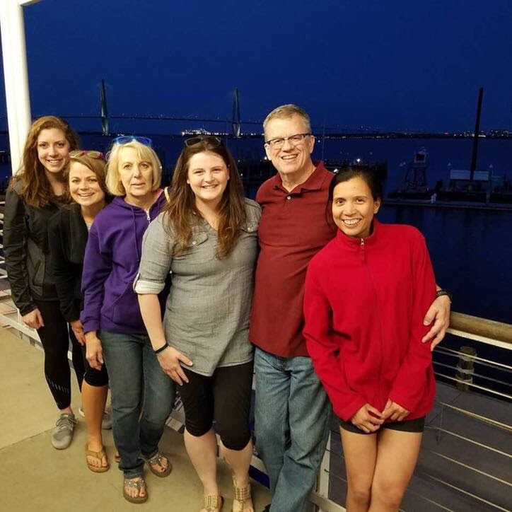 A group of us at the Taste of the Bridge Run event at the Maritime Center with the bridge in the background.
