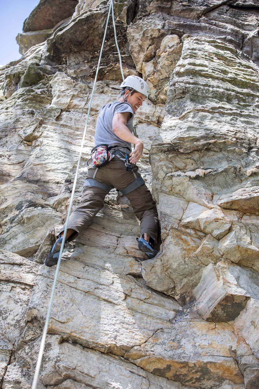 """Emmanuel climbing at Pilot Mountain. """"Shake it off!"""""""