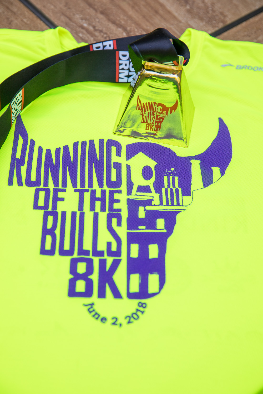 Running of the Bulls 8K 2018 swag - cowbell race medal and tech tshirt