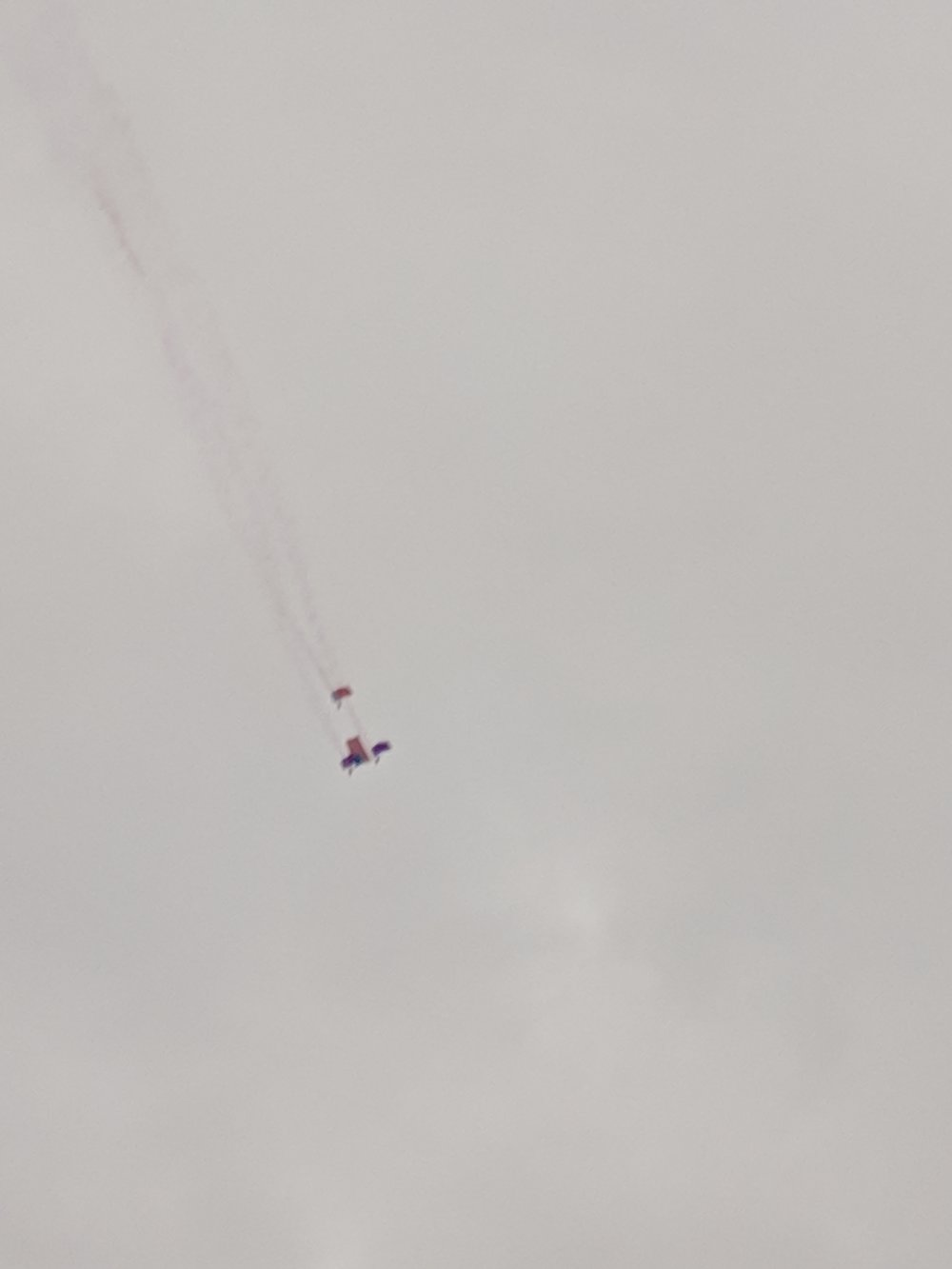 Super blurry image, but at the start line there's a synchronized parachute jump where the parachuters carry the flag through the air. It was pretty cool.