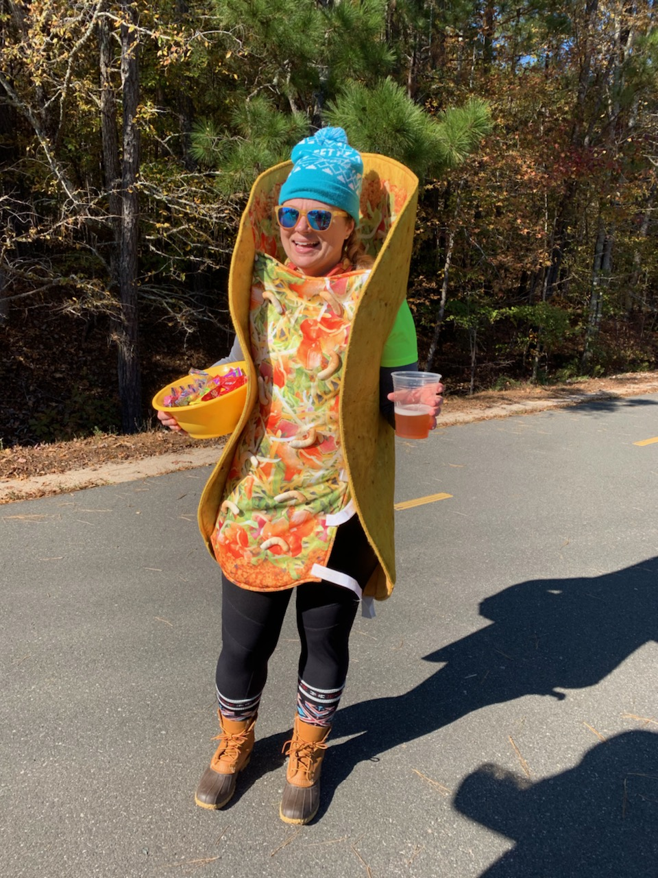 Yup, that's my friend Heather. Cheering on a marathon in a taco outfit. With a beer. And a bowl full of candy dicks. Heather, you're the best.