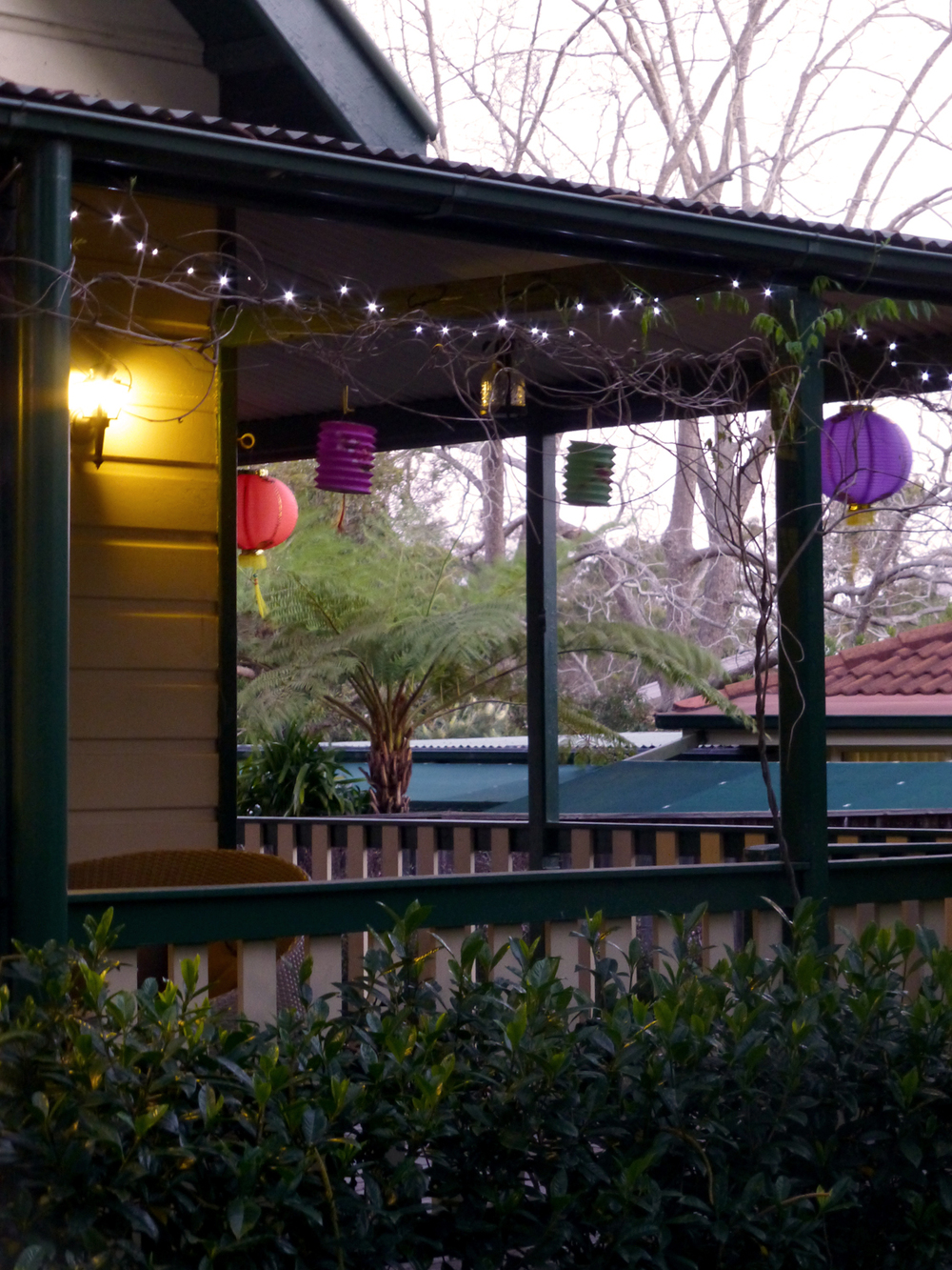 The verandah strung with paper lanterns