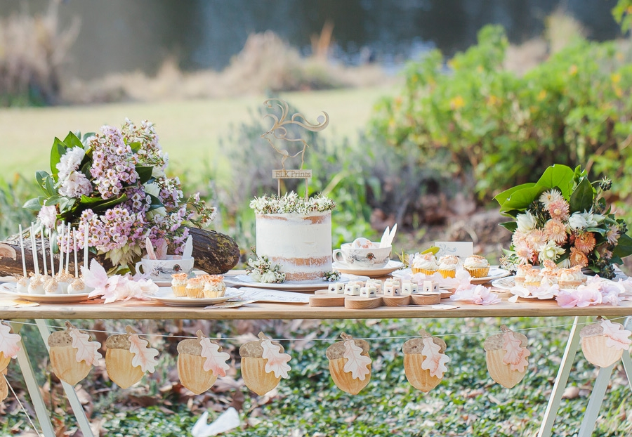 The woodland table filled with flowers of all kinds and sweet things to eat