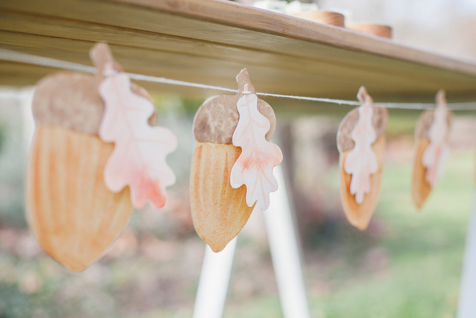 ELK Prints bunting of  Acorns with Oak Leaves  adorns the simple and elegant trestle table.