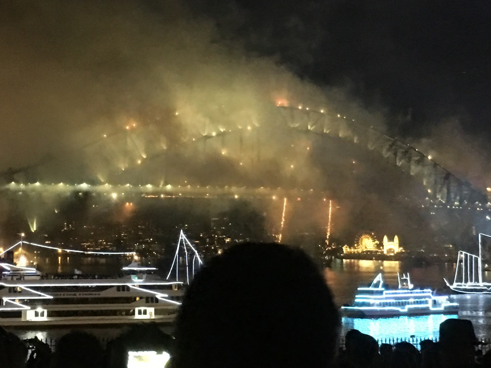 The magnificent haze of firework smoke engulfing the bridge and transforming the landscape