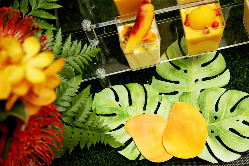 The mangoes and monstera leaves can be used to decorate party plates or a central dessert table.
