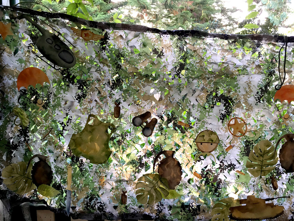The camouflage netting once completed looks beautiful hanging outside against a leafy backdrop - the camouflage netting blending into the background perfectly.