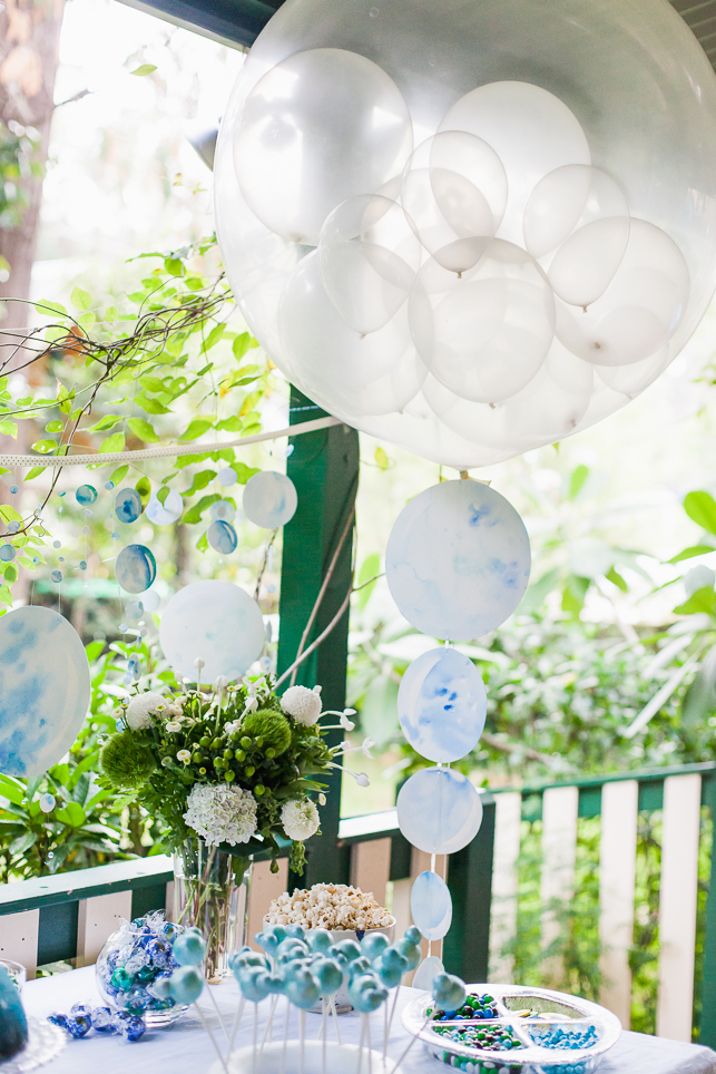 The bubble theme was translated across all the decoration and food choices - custom balloons by Born to Party were finished off  with a hand-painted watercolour tassel by ELK Prints.