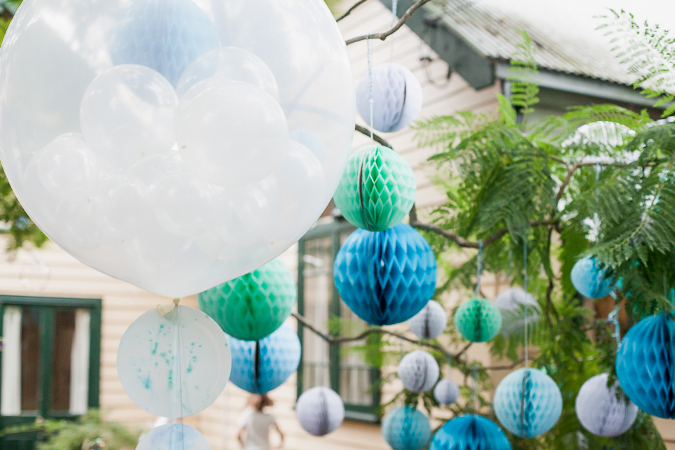 Balloons, watercolour bubbles and honeycomb balls drifts throughout the party.