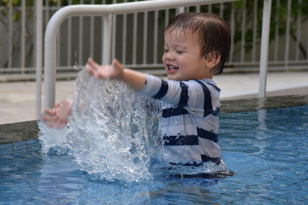 Aiden enjoyed splashing away in the small baby pool.