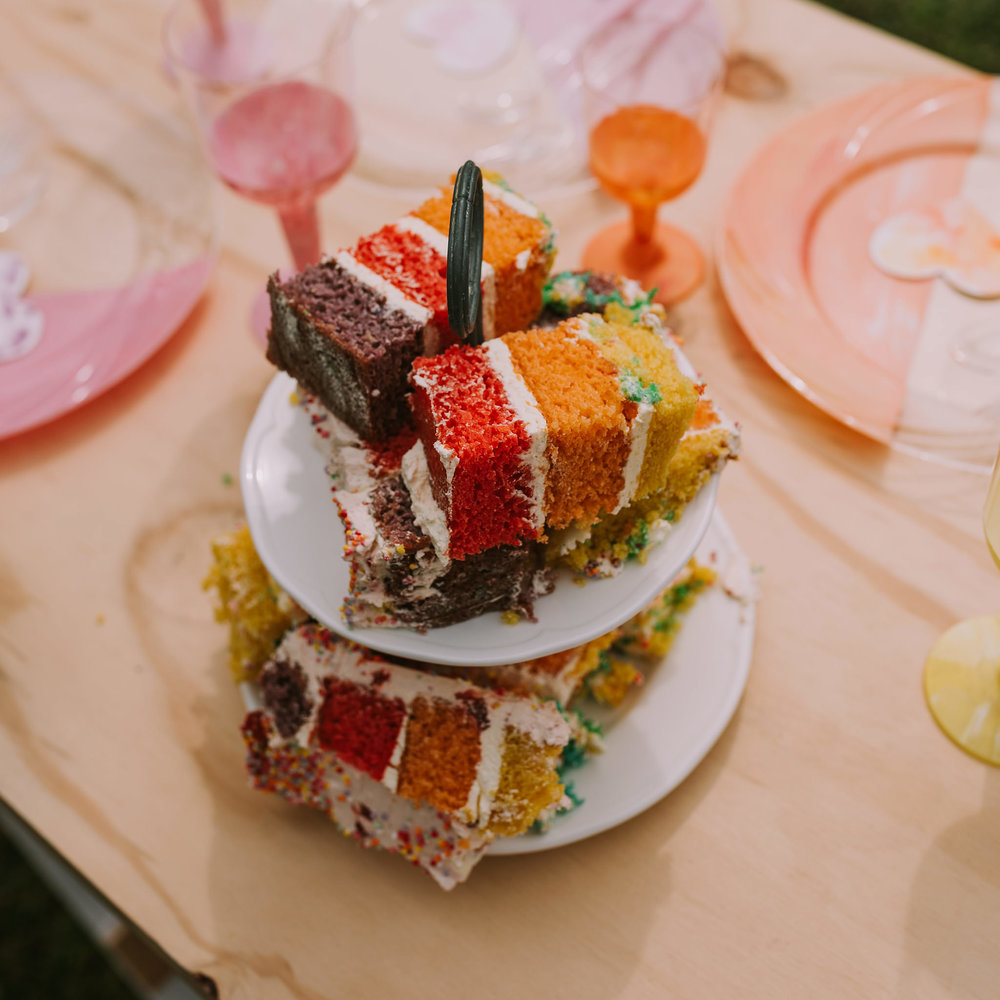 The rainbow layer cake by Baked by Gemma had the most amazingly delicious fresh strawberries and cream icing I've tasted! Photo by Angus Porter Photography