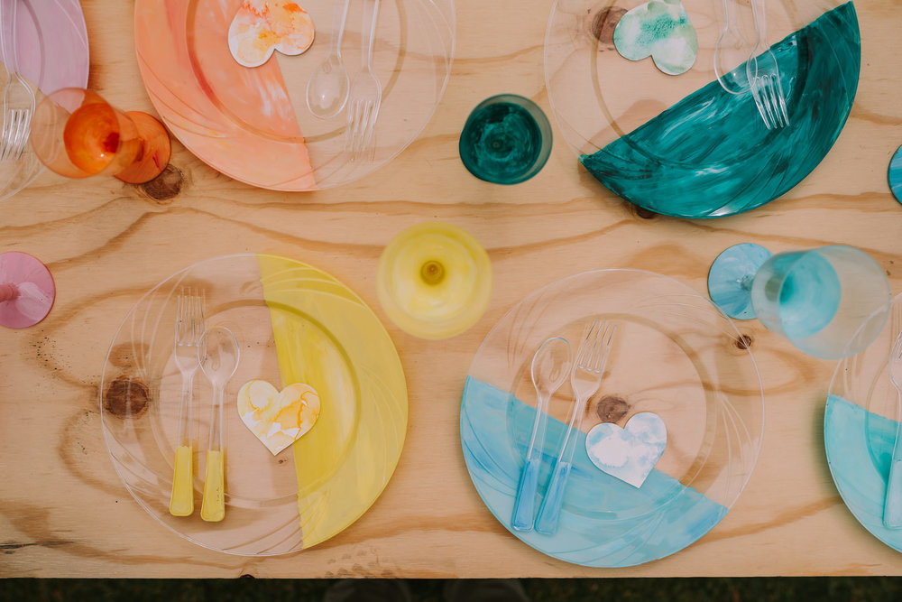 Artistic expression in unison - hand-painted watercolour heart placecards by ELK Prints alongside custom-painted tableware by Upside Down Events. Photo by Angus Porter Photography
