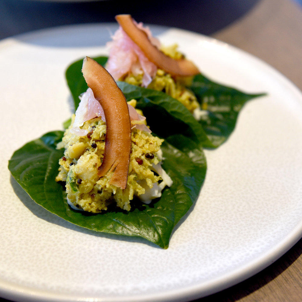 Coconut spiced spanner crab on betel leaf