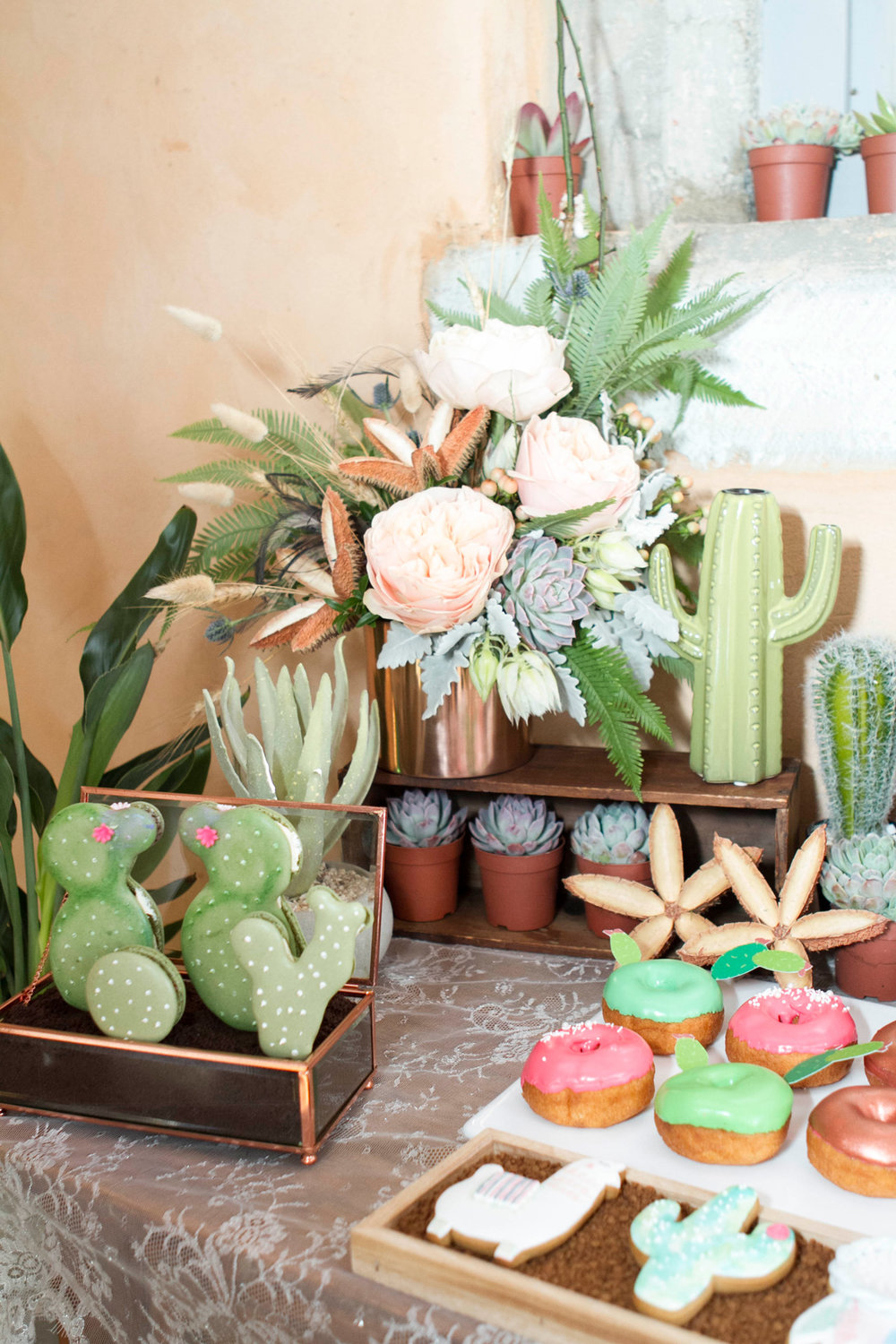 I'm rather in love with the cacti shaped macarons and beautiful decorated cookies