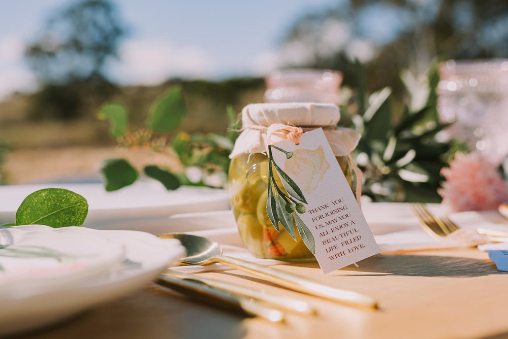 A jar of olives makes the perfect thank you gift for wedding guests.