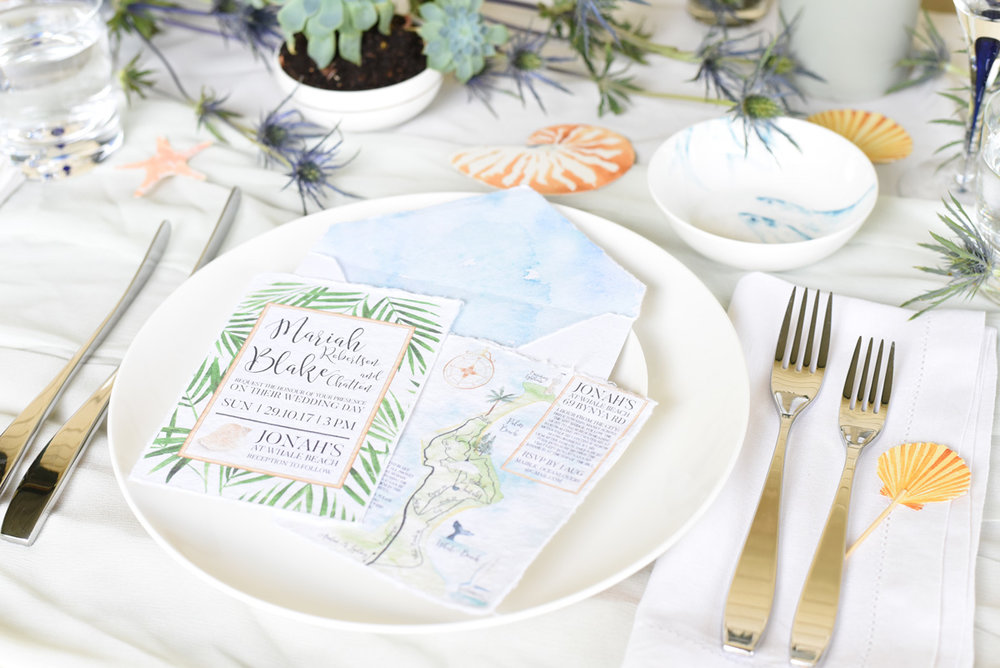 A coastal palm beach wedding invitation suite by ELK Prints in watercolours on Indie handmade paper.