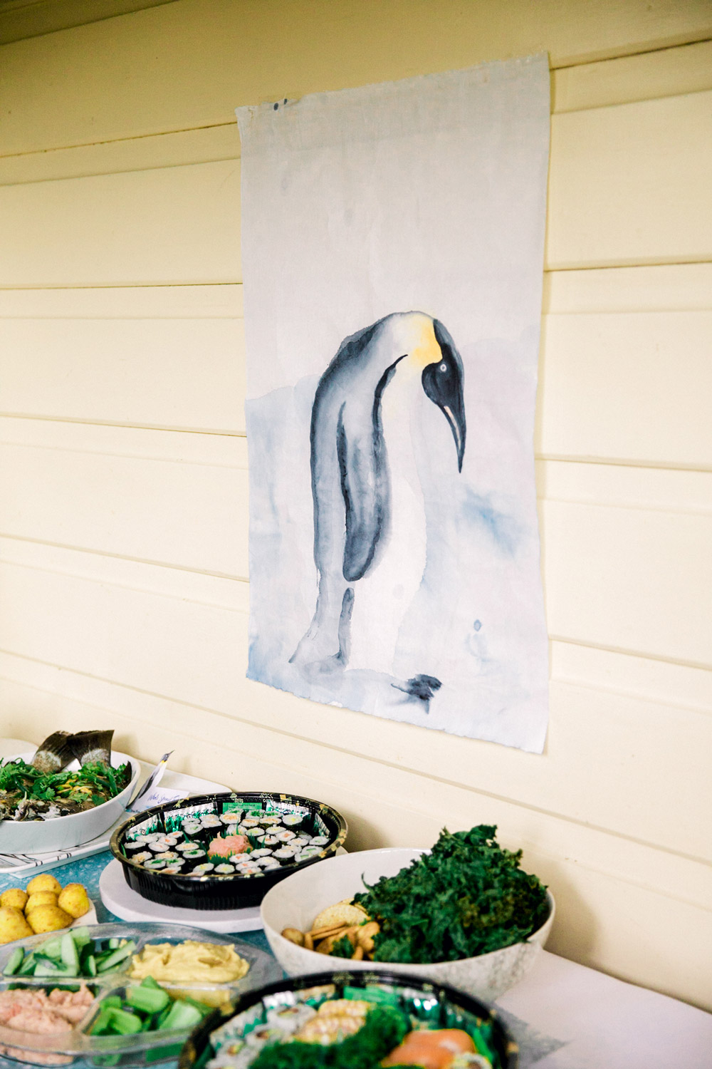 Penguin party food choices included sushi platters, whole steamed fish and kale 'seaweed' chips