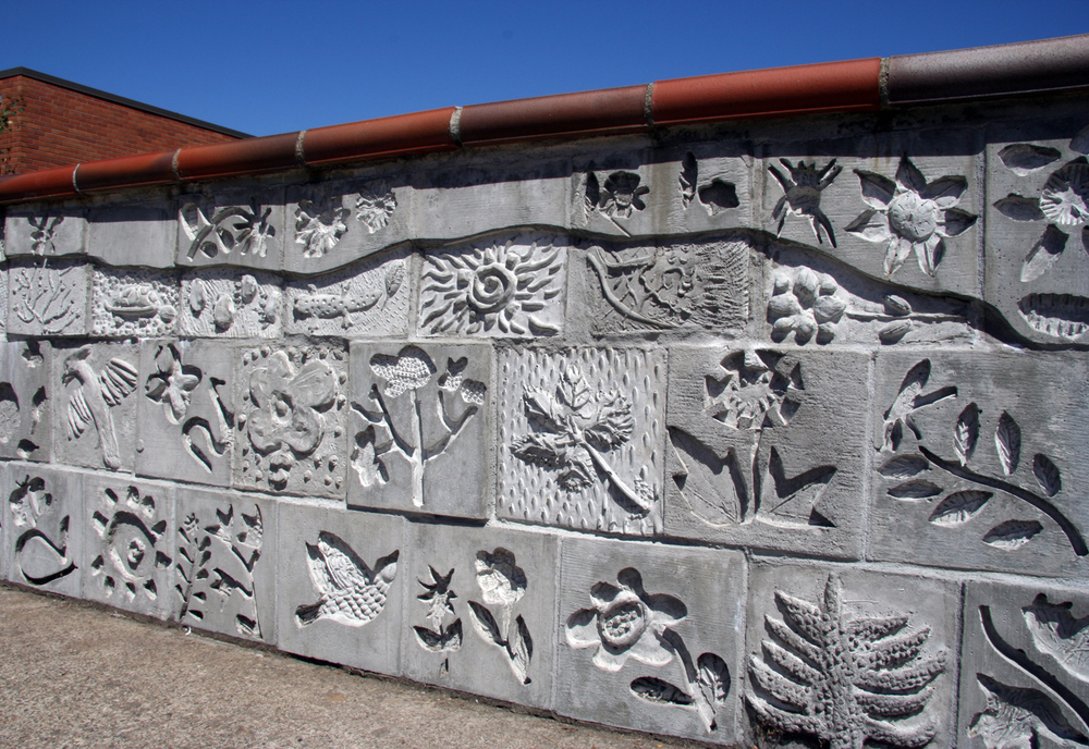 Cast concrete arwork with children and artist Lynn Takata