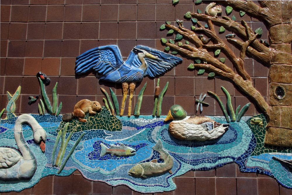 Ceramic relief and mosaic mural with youth