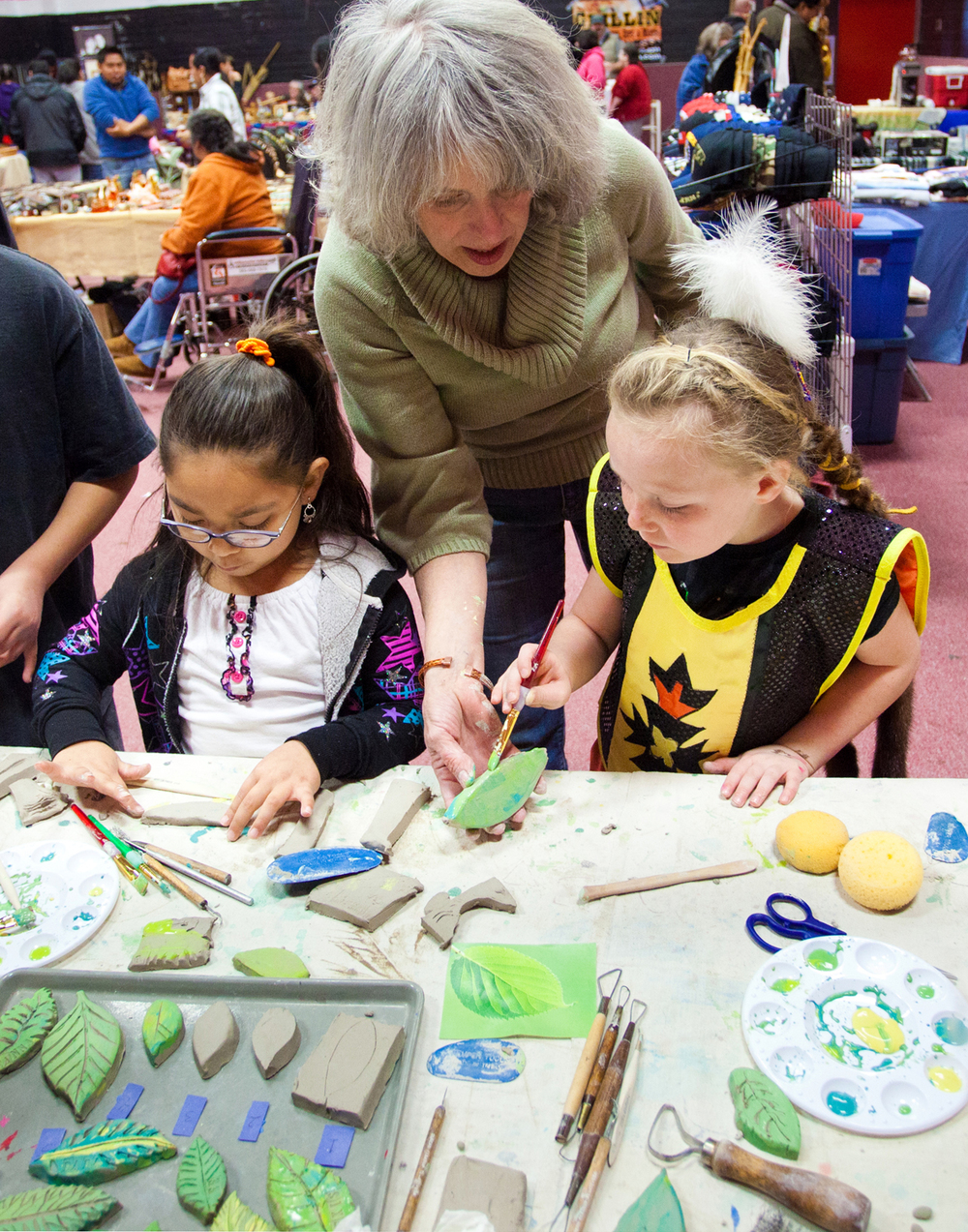Painting leaves at the Chemawa Powow