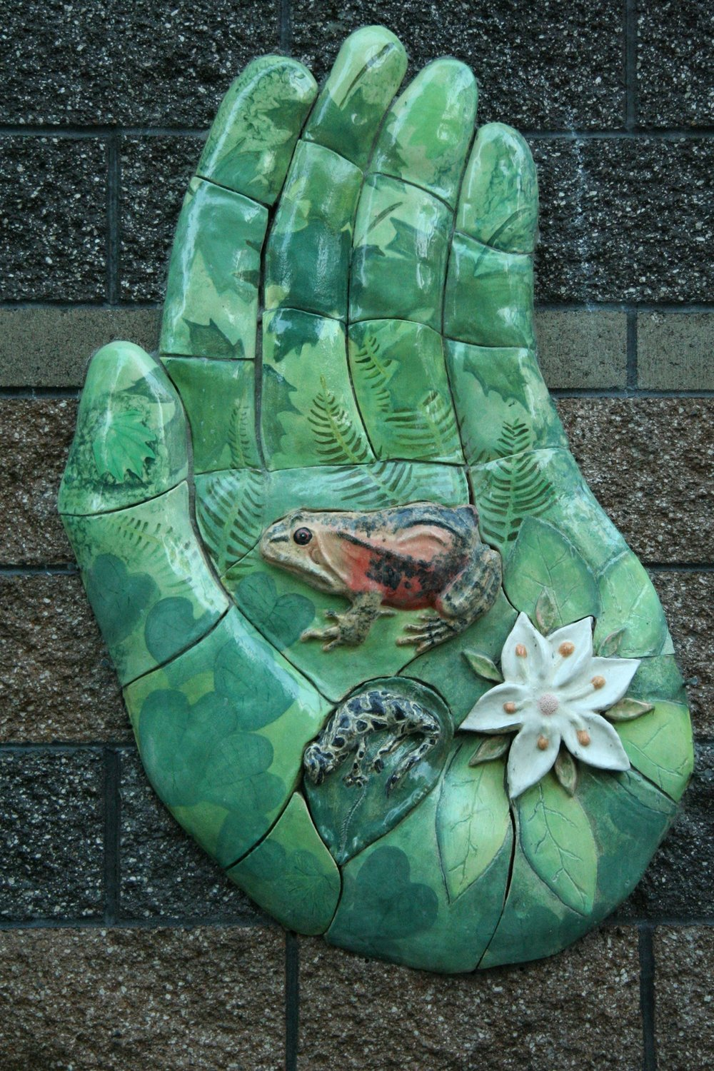 - Students from North Salem High School learned about native species and worked collaboratively to sculpt and paint the bas relief ceramic hand.Big leaf maples, sword ferns, vine maple leaves and a red legged frog are among the images.
