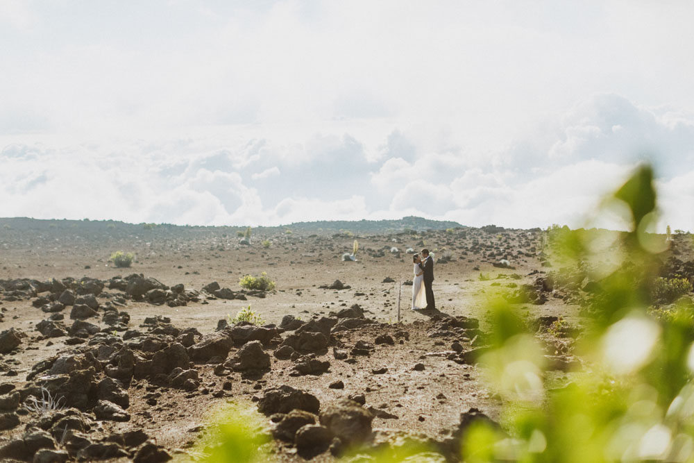 Haleakala Bride and groom walking on lava rock maui