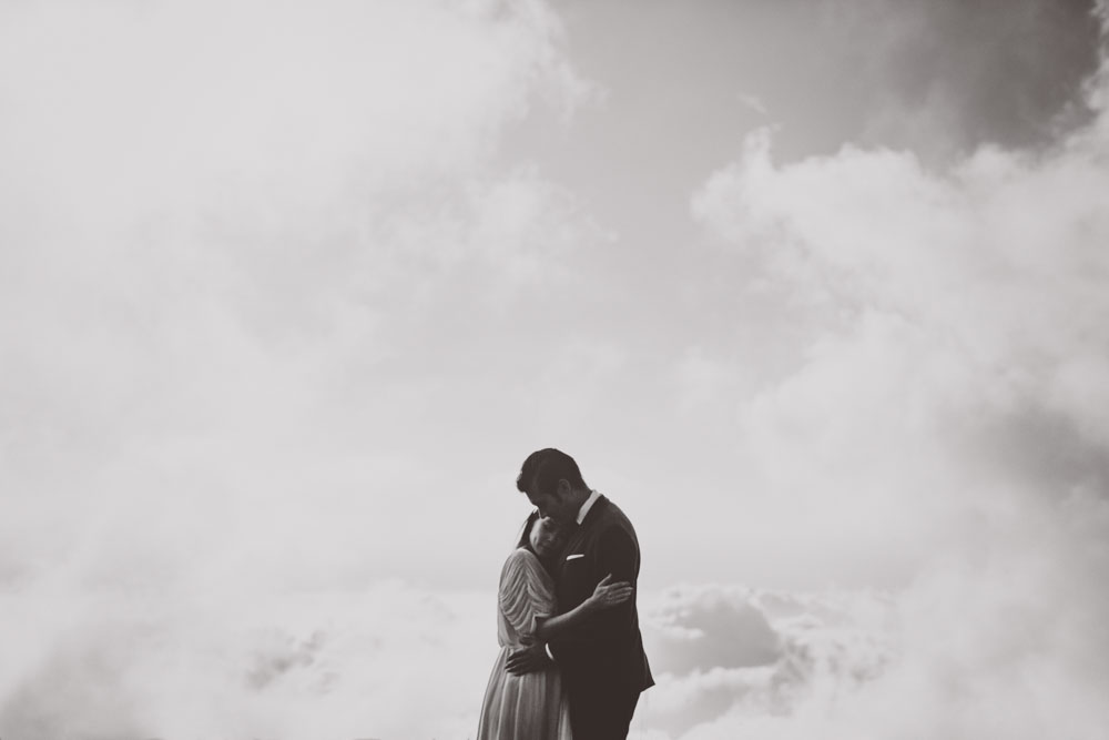 newlyweds on top of the world above the clouds