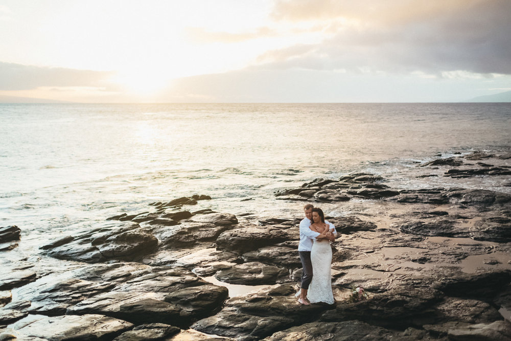 amazing merrimans kapalua wedding sunset view in lava rocks.jpg