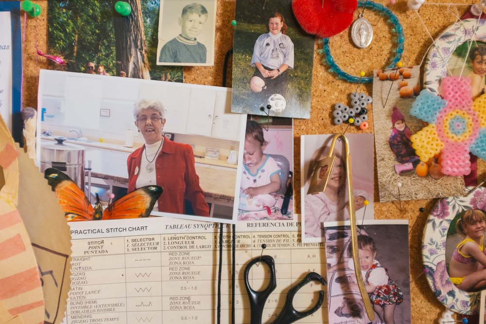 Nan's cork board of memories and trinkets