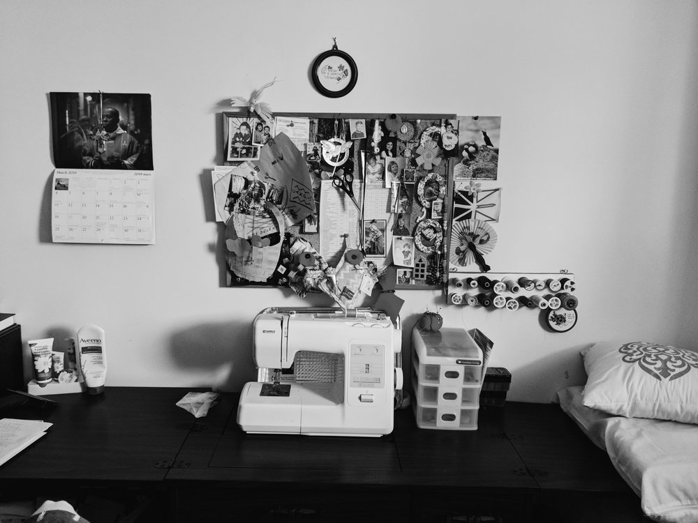 Nan's sewing room with cork board.