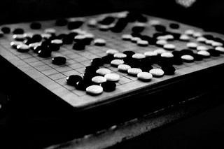 The Game of Go: a Programmer's Perspective   Louis Chatriot,  needforair.com    The game of go is very inter­est­ing from an AI pro­gram­mer's point of view, because of how dif­fi­cult it is to make a com­put­er com­pete against a strong human and how researchers approached the prob­lem. Para­dox­i­cal­ly, the use of ran­dom­…