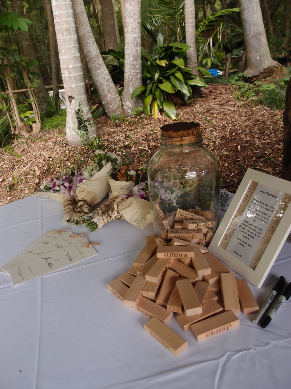 Their guests wrote their well wishes on jenga blocks.