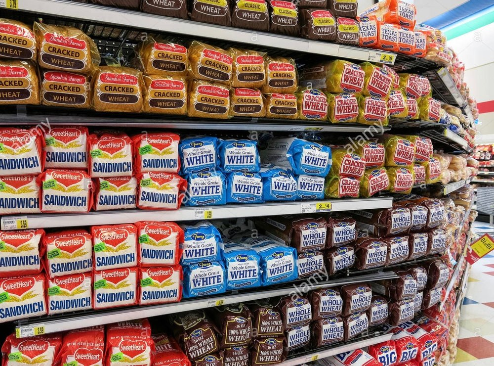 sliced-white-bread-loaves-on-shelf-smiths-grocery-store-great-falls-E64H3N 2.jpg