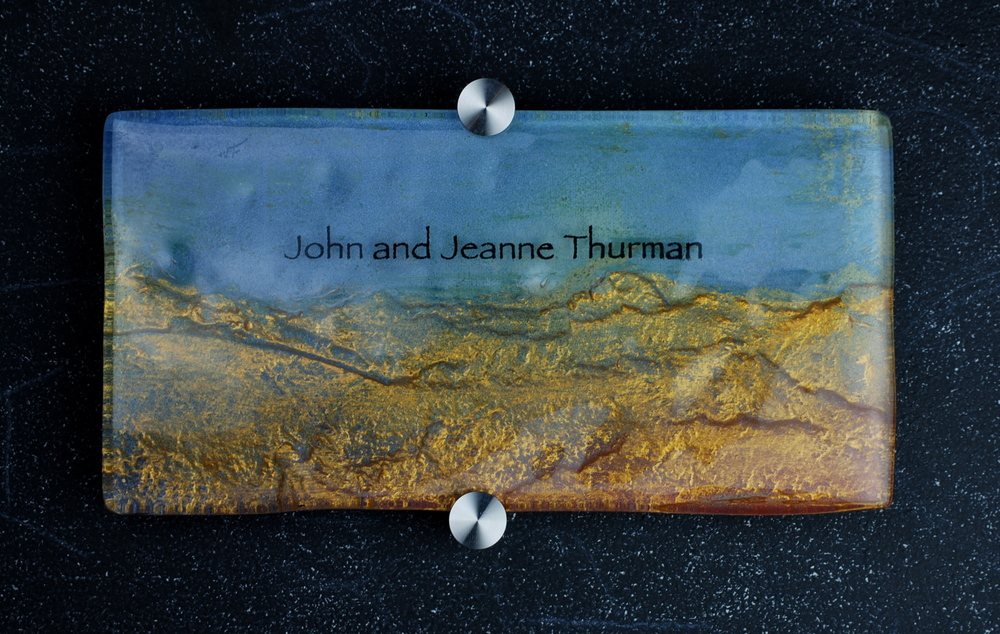 Donor Recognition Plaque - Fused and hand-painted glass with gold mountains and a blue color palette.