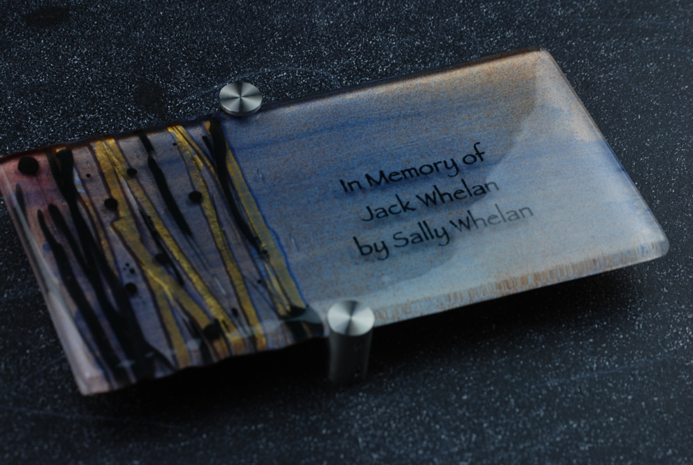 Donor Recognition Plaque - Fused and hand-painted glass with bronze and black ribbons on blue color palette.