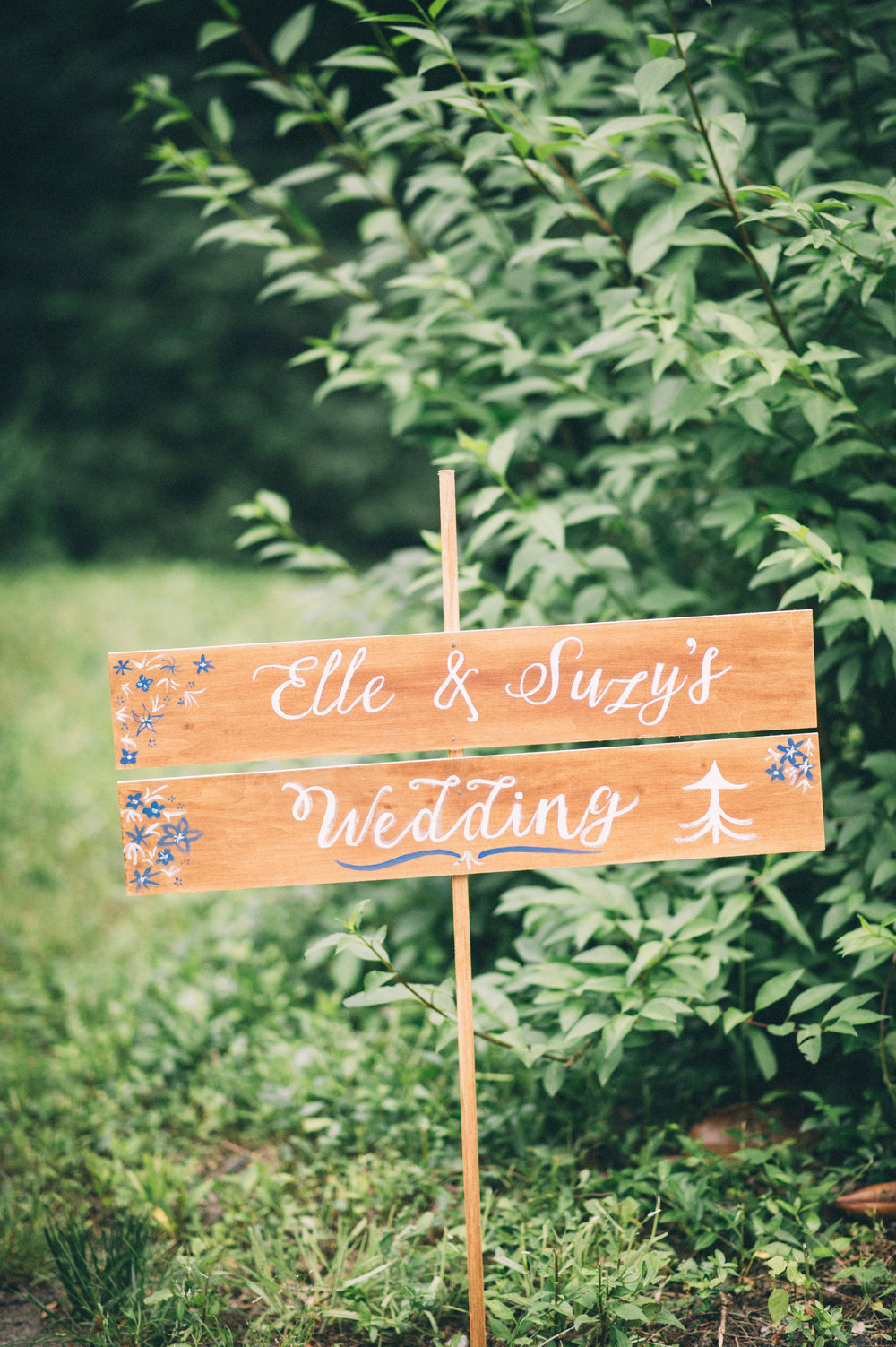 Elle & Suzy // Spring Wedding at the Lincliffe Estate // LGBTQ Kentucky Wedding Photographer // Louisville Engagement Photography // Wood Welcome Sign