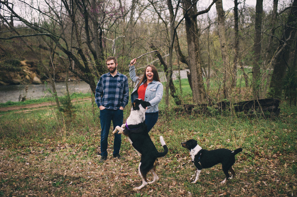 Maggie + Corey Adventurous Engagement Session- Sarah Katherine Davis Photography - Cherokee Park Hike - Louisville Kentucky - Playing Fetch with Dogs