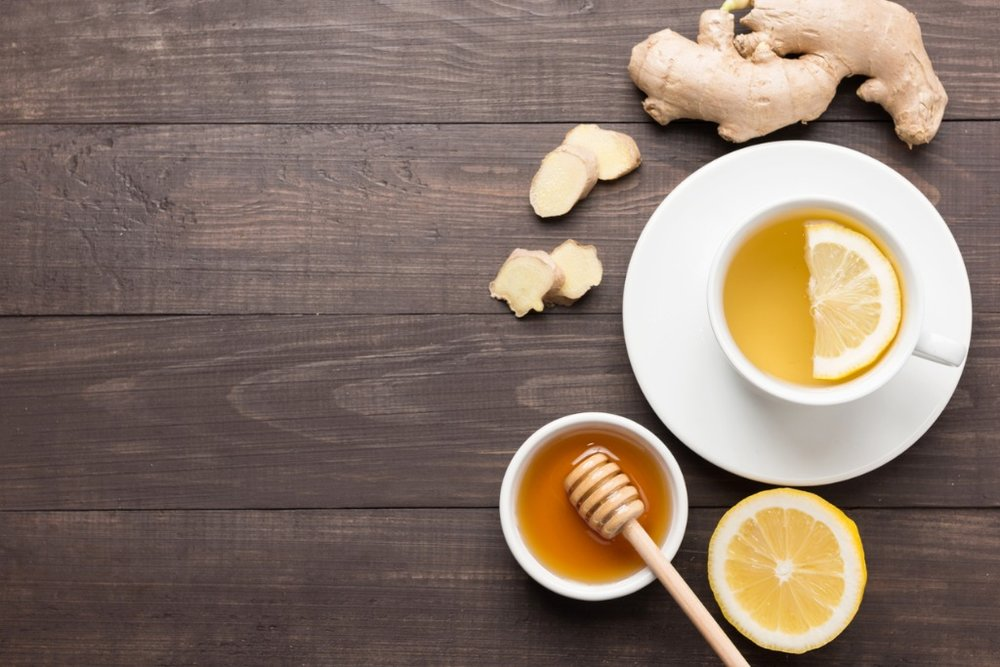 cup-of-ginger-tea-with-lemon-and-honey-on-table-picture-id640237322.jpg