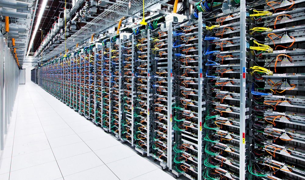 Racks of Google servers and color coordinated cabling