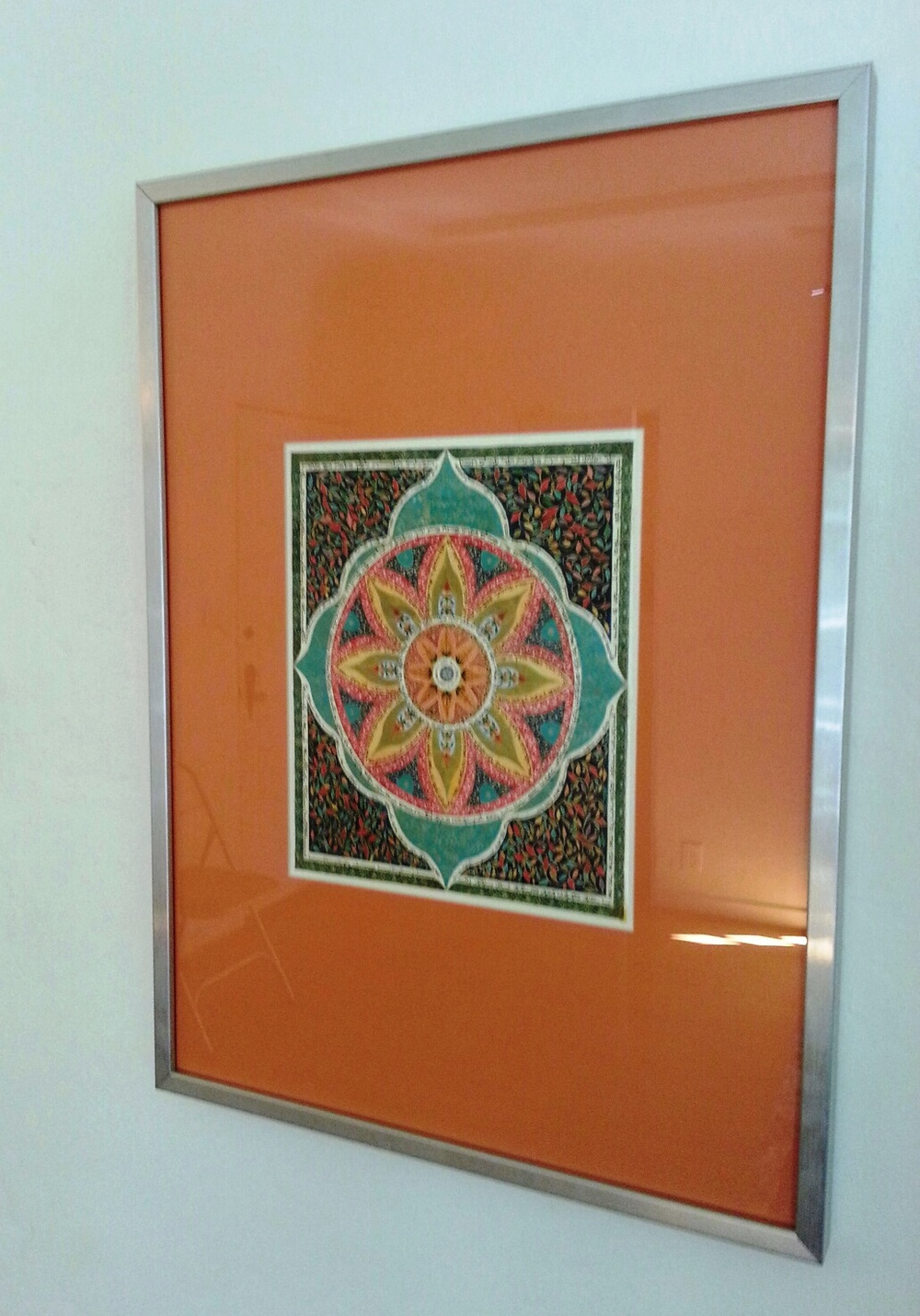 I stuck this print I found in Israel in a frame from IKEA.  I chose a tangerine colored wide mat so that the print would appear grander.  Size matters.