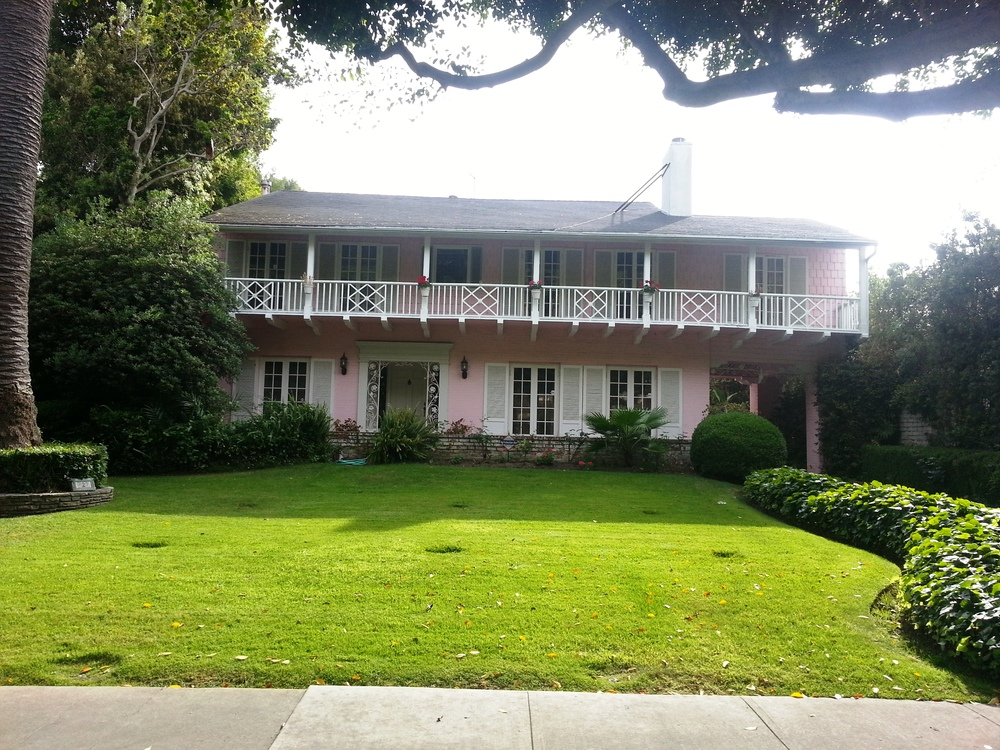 Of course Marilyn Monroe's house is cute and pink.  This is exactly the house I would have dreamed up for her.