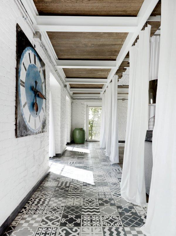 Umbrian home designed by Paola Navone, a mix of Moroccan tiles of her own design, from Carocim .