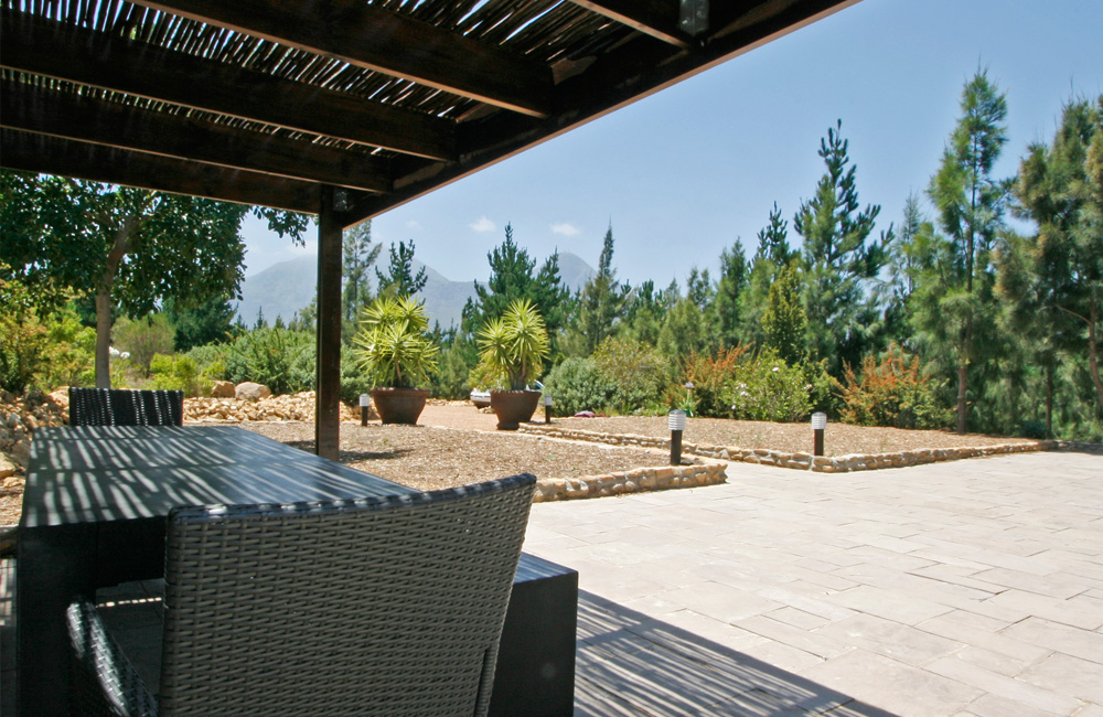 Phezulu Lodge – shaded patio with the Hollland Hottentot Mountains in the distance