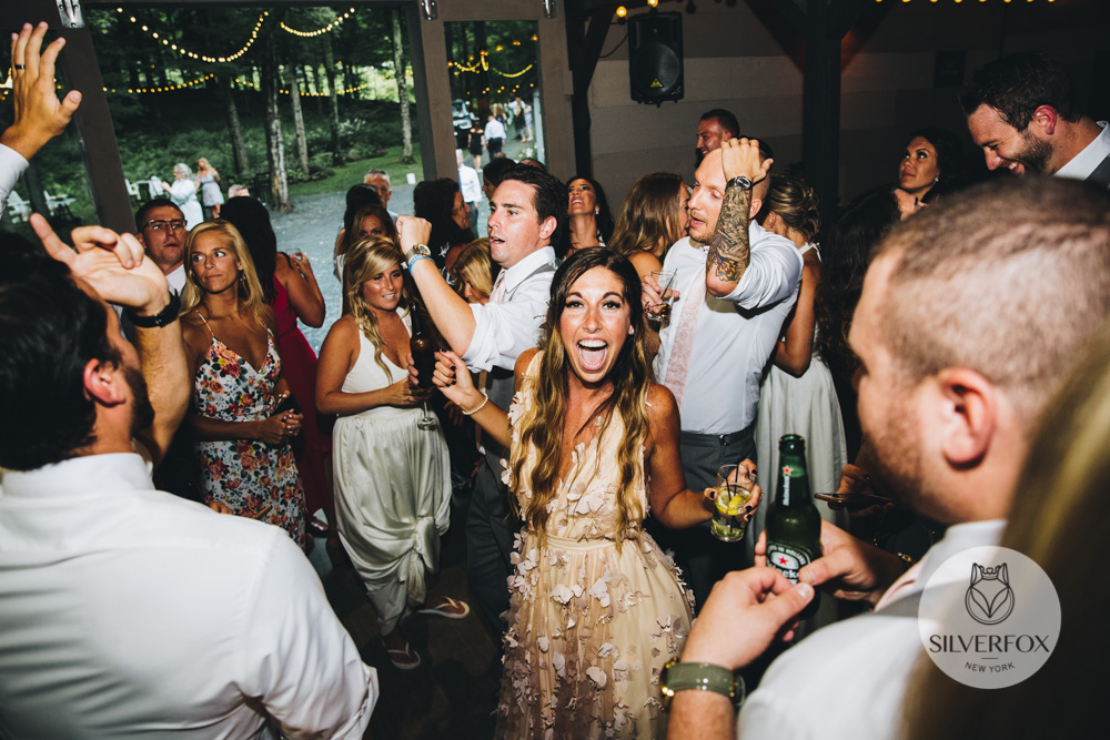 "Any other special stories or details?:   Mike had planned to propose to me on stage at our favorite bands concert. We have been following The Revivalists since Mike found them at Bonnaroo Music and Arts Festival in 2013. Mike took me to their concert as one of our first dates and I was hooked. We then saw them any chance we got and even spoke to them on a few occasions about how incredible their music was. They were just a group of town to earth and incredibly talented guys that truly appreciated the love and support. We attended their concerts at Brooklyn Bowl, on a boat cruise around Manhattan, at smaller venues in Manhattan, we saw them in Central Park and every time we heard them we knew they were on their way to making it big. Their hit song ""Wish I Knew You"" came out a few months prior to our engagement and we had bought tickets to see them at another Manhattan venue, The Playstation Theater. Mike reached out their tour manager asking him if he could propose to me on stage, seeing as all the concerts were always very small and intimate. The tour manager told him he wished he could but this show was their big moment to go from a New Orleans funk band to rockstars. Mike simply couldn't wait any longer so he proposed to me the following day. We dedicated our first dance to The Revivalists by dancing to their song Soulfight. The Revivalists, Bonnaroo Music & Arts Festival and everything in between are what helped Mike and I fall in love. The love we both have for music, a sense of community and home, radiating positivity and each other is why I found my soulmate."