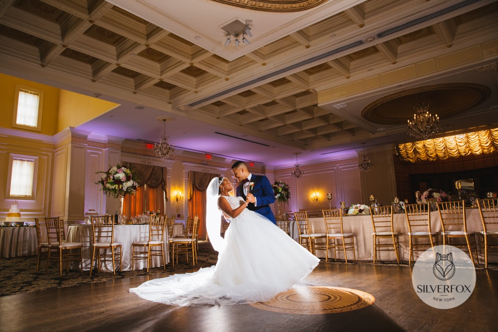 Who are your vendors?:   Venue: The Inn at New Hyde Park Transportation: Camelot Limos Florist: Flowers by Brian Wedding dress: Kleinfeld Bridal Salon, designer: Allure Bridal Veil: David's Bridal, Shoes: Badgley Mischka, Jewelry: Nordstrom Nadri Bridal Jewelry Jeweler: Diamonds by Janet Menswear: Groomsmen tux = Men's Warehouse, Groom tux = Alton Lane Bridesmaids dresses: David's Bridal Photographer and video: Silverfox Music/entertainment: Remixologists  Stationary: Minted.com Hair and make up (bride, bridesmaids and brides mom): Beauty by Eunii Cake: Dortoni Bakery and Pastry Shoppe