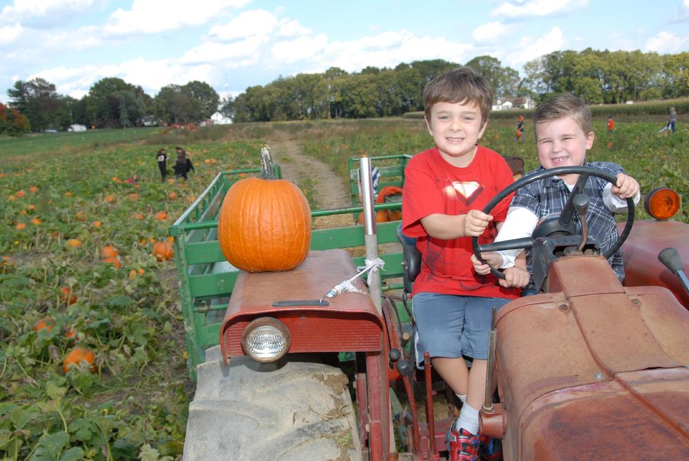 2 kids on tractor.JPG