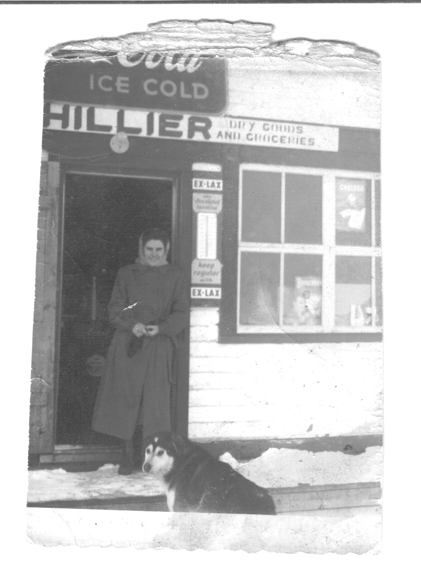Newfoundland - Zilda Hillier in front of Donald Hillier's store.jpg