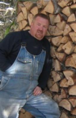 Carl by wood pilewebsitever.jpg