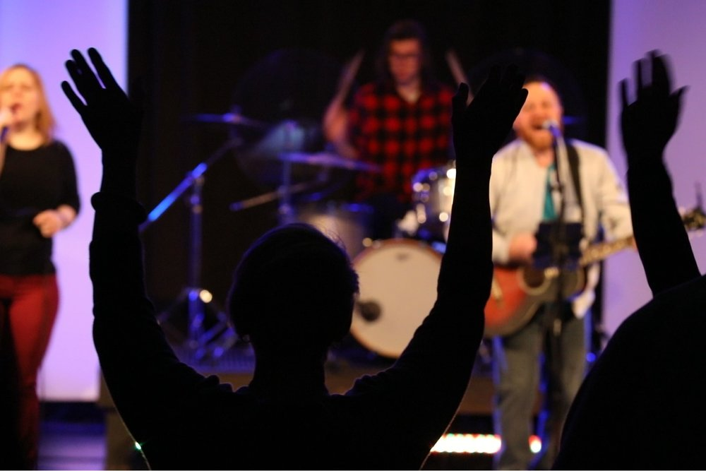 """Music - We are passionate about worshiping our creator through song. You'll experience a full band leading the audience in an upbeat, engaging time of worship music. The lyrics will be projected to a screen so you can sing along. Psalm 150:6 says """"Let everything that has breath praise the Lord."""" We get excited! You'll see people clapping, raising their hands and expressing their joy. You are welcome to join right in with us."""