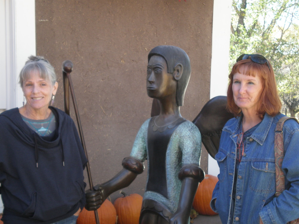 Kathleen and Beth with another of Marco's sculptures in front of Rancho de Chimayo